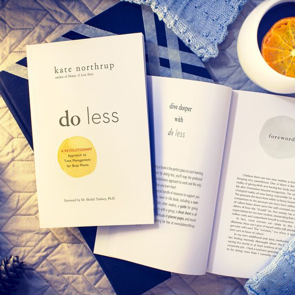 Image of Do Less Book Sitting on a countertop next to a drink
